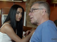 Old fart fucks beautiful young brunette Anna befitting on the table readily obtainable the bar