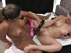 Big tits lesbians upbraiding with toys