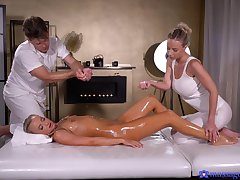 Oiled impoverish gets lucky and fucks duo models on the massage table