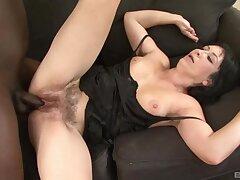 Horny mature Eva gives head and rides his giant black bushwa